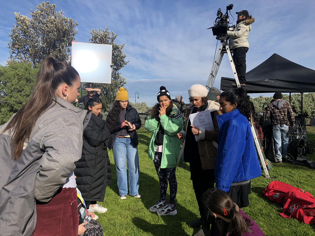 Mustangs FC Episode 5 Director Amie Batalibasi on set with cast and crew.